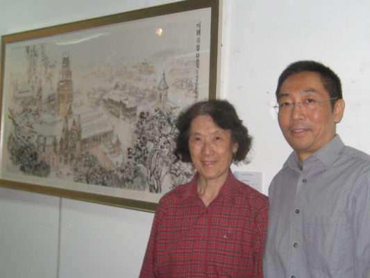 Chen Hao and Xu Fangfang with Chen's ink brush painting, Harvard University Campus.